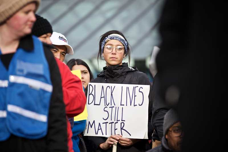 TRIBUNE PHOTO: JAIME VALDEZ - Protesters carry Black Lives Matter signs during a recent march for racial justice and equality.
