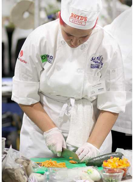 SETH GORDON - Newberg High School senior Taylor Coen      flashes her knife skills during the 2016 Oregon ProStart Culinary Championships. Coen and four other NHS           students will   compete in this        year's event Saturday in    Salem.
