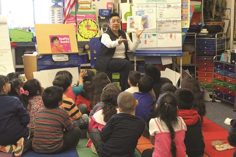 INDEPENDENT FILE PHOTO - Rosa Floyd, a kindergarten teacher at Nellie Muir Elementary School, reads to her class in this file photo.