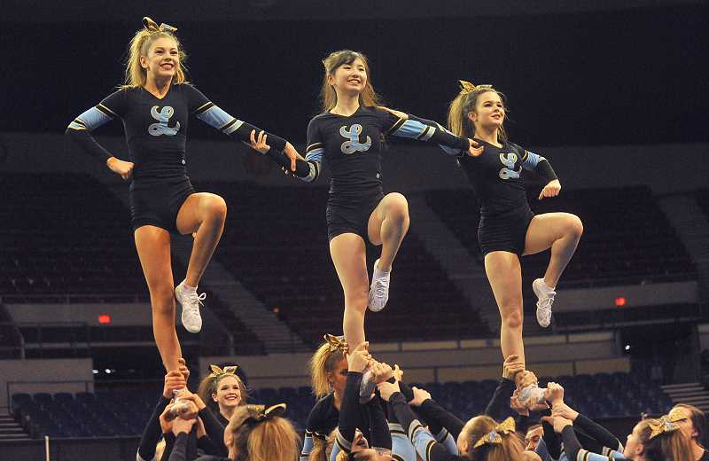 REVIEW PHOTO: VERN UYETAKE - Lakeridge cheerleaders strike a pose at the state championships.