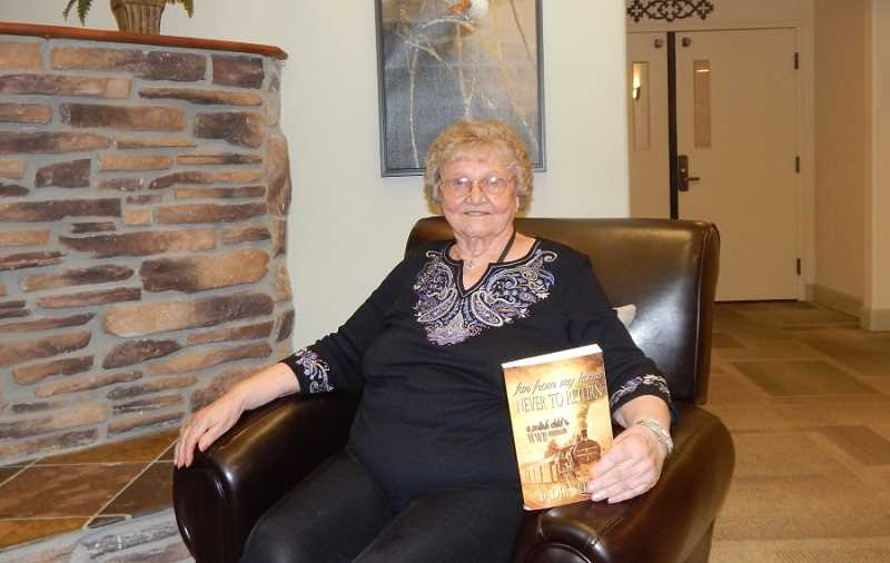 BARBARA SHERMAN - Nadia Seluga, holding the book she wrote about her refugee family surviving World War II, lives at Woodland Heights in Tigard.
