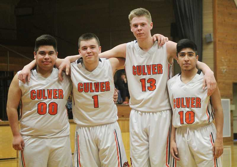 WILL DENNER/MADRAS PIONEER - Culver boys basketball seniors, from left, Tony Olivares, Ian Stevens, Mike Davis and Chris Munoz-Toledo pose as all four checked in during the fourth quarter against Weston-McEwen last Saturday on senior night.