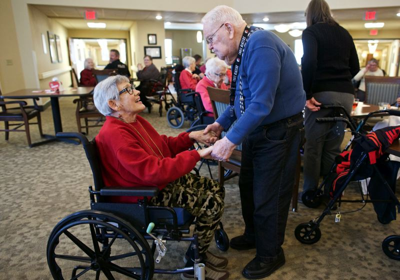 TIMES PHOTO: JAIME VALDEZ - From left, Fran Rycewicz and Elmer Ballard, residents of Marquis Tualatin Assisted Living, dance at a Valentine's Day ball at the facility.