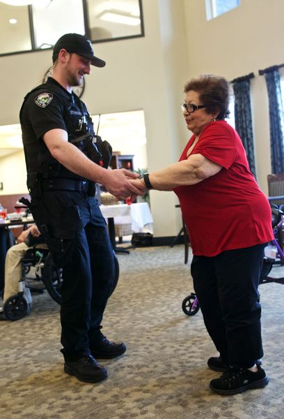 TIMES PHOTO: JAIME VALDEZ - Tualatin Police Officer Shawn Fischer dances with Manzar Baradar, a resident at Marquis Tualatin Assisted Living, during a Valentine's Day ball.