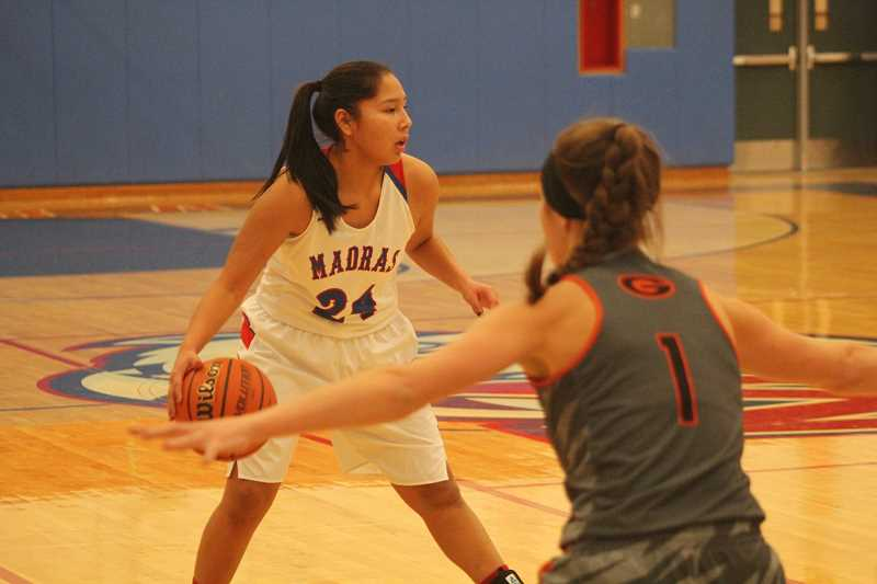 WILL DENNER/MADRAS PIONEER - Madras freshman Jiana Smith-Francis (24) looks to pass in the first quarter against Gladstone.