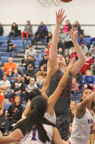 WILL DENNER/MADRAS PIONEER - Gladstone forward Sophia Hollingsworth puts up a shot against Madras defenders in the third quarter.