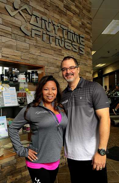 STAFF PHOTO: VERN UYETAKE - West Linns Anytime Fitness owners Heidi and Kalani Pa are looking forward to reopening their gym in Lake Oswego in March.