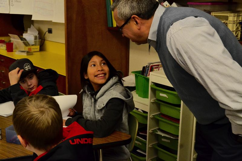 POST PHOTO: BRITTANY ALLEN - Al Sigala entertains a question from a student at Naas Elementary School.