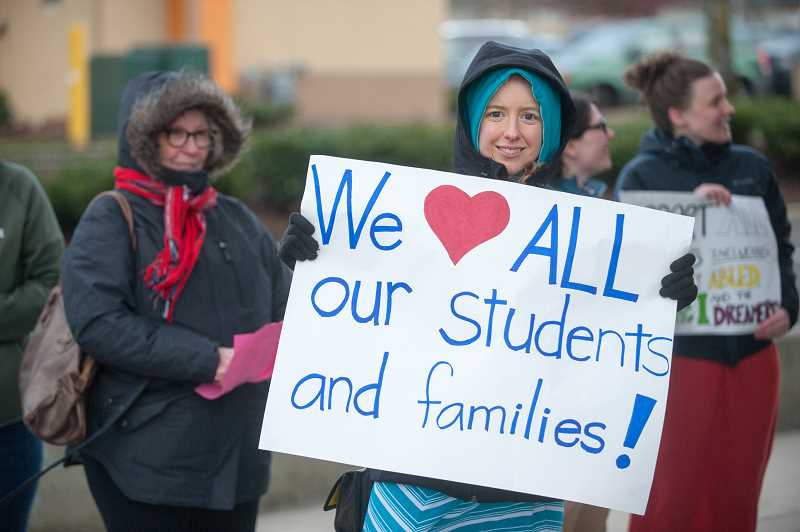 OUTLOOK PHOTO: JOSH KULLA - Gresham-area teachers rally in front of the East County Courthouse Monday in support of education funding and related topics.