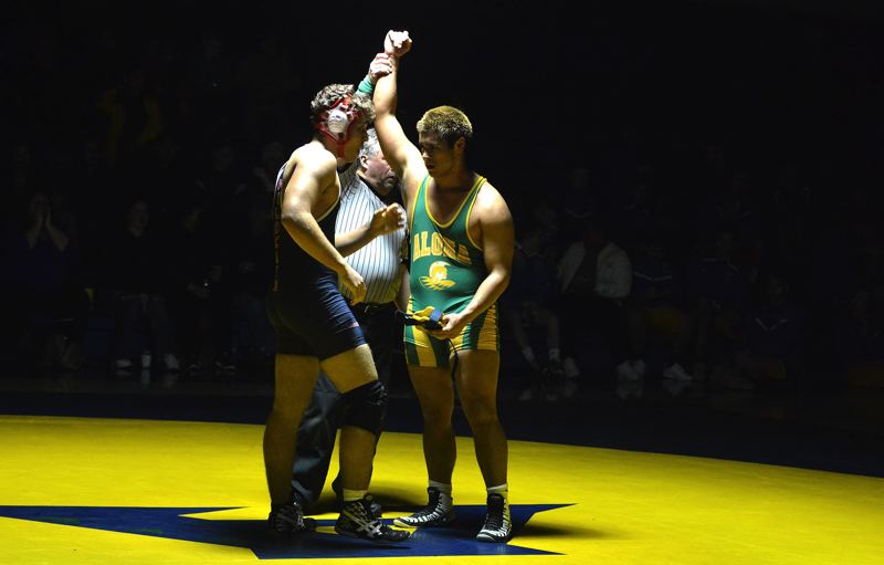 TIMES PHOTO: MATT SINGLEDECKER - Aloha senior wrestler Ricky Tilbury won by fall against Westview last week at Aloha High School.