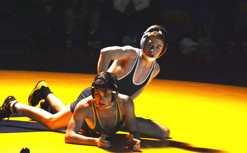 TIMES PHOTO: MATT SINGLEDECKER - Westview sophomore Joey Coste won by major decision against Aloha.