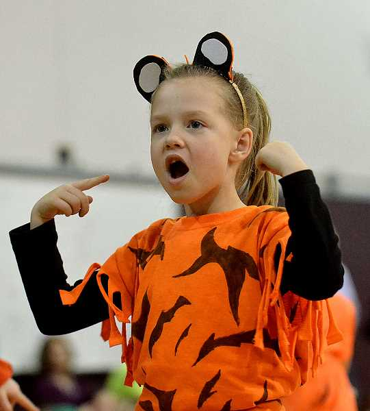 TIDINGS PHOTO: VERN UYETAKE - First-grader Sophie Turner performs 'Roar!' Friday, Feb. 10 at Willamette Primary.