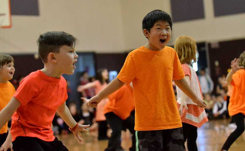 TIDINGS PHOTO: VERN UYETAKE - First-graders Charlie Connor, left, and Lucas Wang, right, perform 'Roar!'