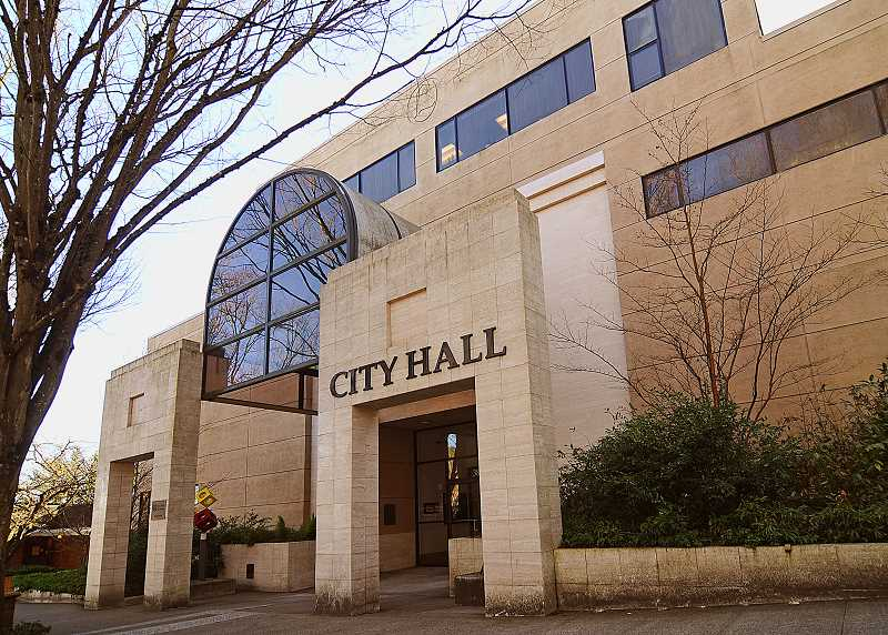 REVIEW PHOTO: VERN UYETAKE - City Hall's exterior skin has been corroded by years of water leaks and the building does not meet current seismic standards, prompting officials to compare the cost of repairs against the price tag for replacement.