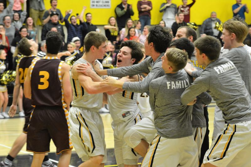 SPOTLIGHT PHOTO: JAKE MCNEAL - Junior guard Nate Shaffer and the Lions boys' basketball team celebrate senior forward Matt Anderson's game-winning lay-in in their 73-71 home win over Milwaukie on Tuesday.