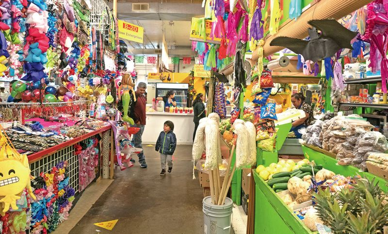 COURTESY PHOTO - Jaime Miranda, who owns Hillsboro's M&M Marketplace,  saw business cut in half with implementation of a 2008 state law requiring proof of citizenship to get a license.