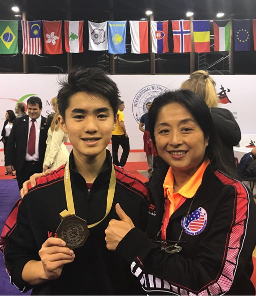 COURTESY PHOTO - Alexander Yu, posing for a photo with his mother at the World Tai Chi Championships, says of martial arts: 'It's hard to imagine another life. I've just been doing this as long as I can remember.'