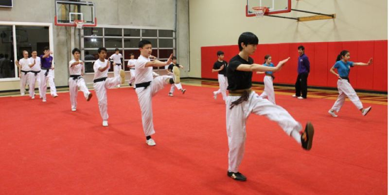 COURTESY: LYNDSEY HEWITT - Students go through drills at the U.S. Wushu Center.