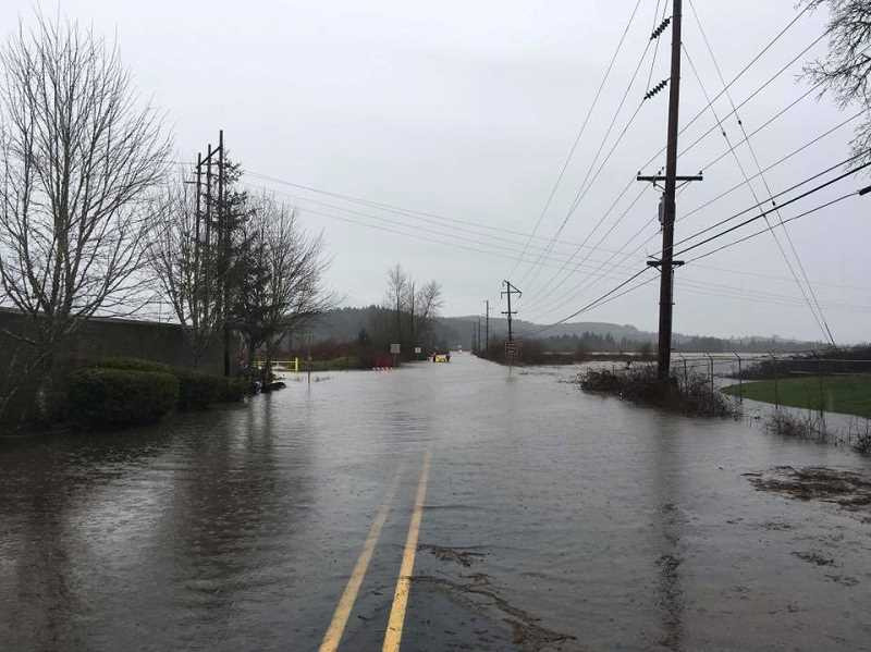 SUBMITTED PHOTO: FOREST GROVE FIRE & RESCUE - Fernhill Road near Taylor Way was completely covered in water Thursday afternoon when a 911 caller reported seeing someone possibly driving into the dangerously flooded area.