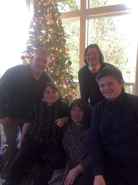 BATES FAMILY PHOTO - The Bates family in a holiday photo. Pictured left to right: Steve Bates, Joey, 10, Amber Bates, Jacob, 16, and Michael, 13.