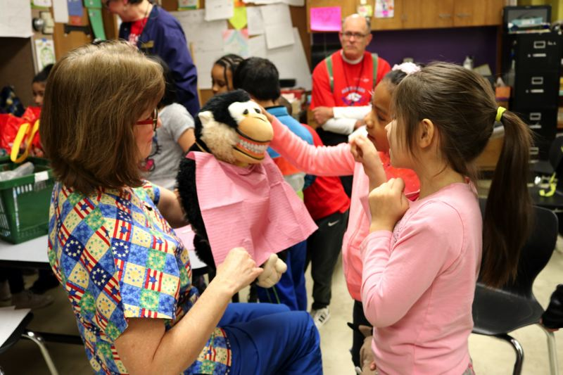CONTRIBUTED PHOTO - Students learn about brushing habits from dental hygienists.