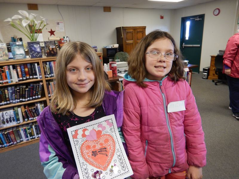 COURTESY PHOTO OF CHIP GARDES - Katelyn Wells and Addison Wells at the Columbia City Community Library on Saturday, Feb. 11.