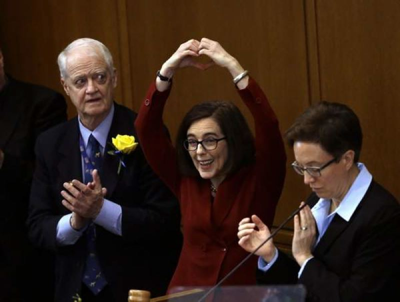 FILE PHOTO - Peter Courtney (left) and Tina Kotek (right) stand with Gov. Brown.