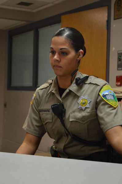 SPOTLIGHT FILE PHOTO - Columbia County Sheriff's Office jail deputy Michelle Vandenberg reviews inmate records on a computer at the Columbia County Jail. The jail detains most people arrested in the county, but the CCSO never makes arrests based on immigration violations.