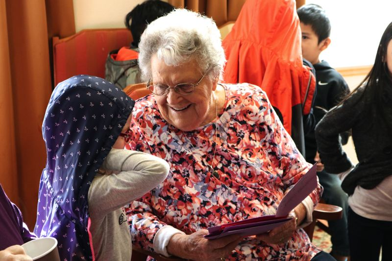 CONTRIBUTED PHOTO - An appreciative resident of Cherry Park Plaza admires a Valentine's Day missive deliverd by a Wilkes Elmentary School first-grader.
