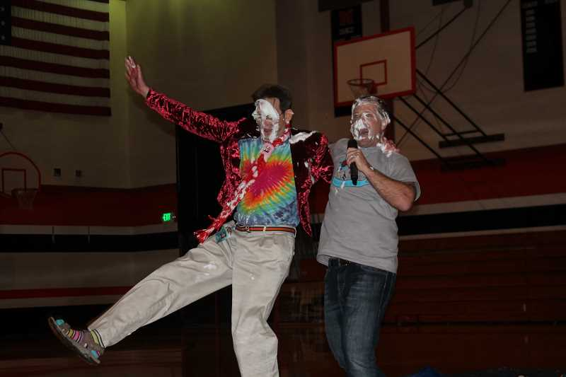 PIONEER PHOTO: CONNER WILLIAMS - Science teacher Joe Zenisek sings and dances with principal Randy Dalton after they hit each other in the face with pies.