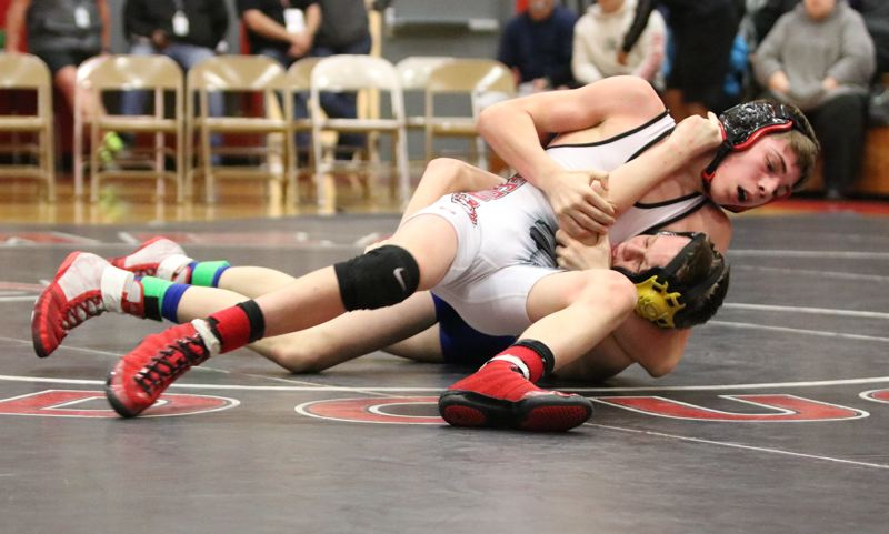 Oregon City wrestlers fall two points shy of district title