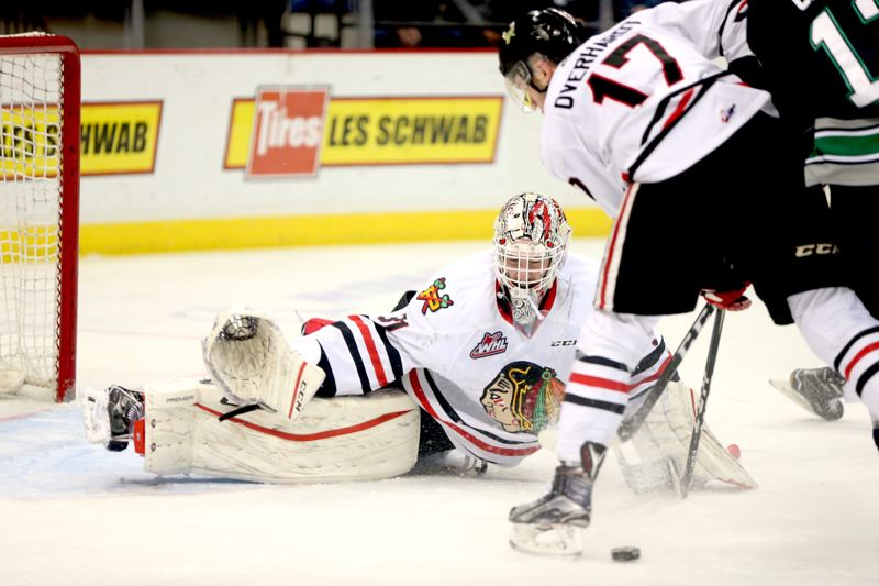 COURTESY:BRYAN HEIM/PORTLAND WINTERHAWKS - Portland Winterhawks goaltender Cole Kehler prepares to make a save against the Seattle Thunderbirds,