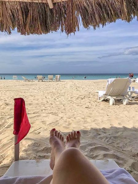 CONTRIBUTED PHOTO: LILA REED - If youd  rather have some down time on the white sandy beach, then put up your feet and the red flag.