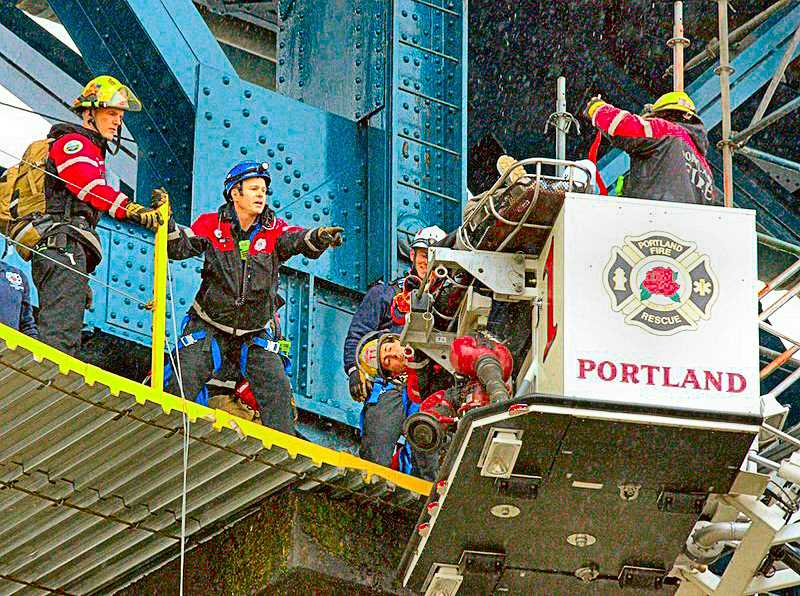 COURTESY OF PORTLAND FIRE AND RESCUE - Firefighter/paramedics used an aerial platform on Truck 1 to reach workers injured at the current Ross Island Bridge repainting project.