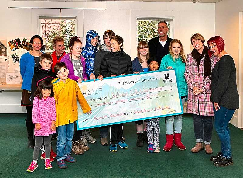 DAVID F. ASHTON - Sellwood Middle School students presented a giant ceremonial check that will be shared by both the SMS Parent Teacher Association and SMS Foundation.