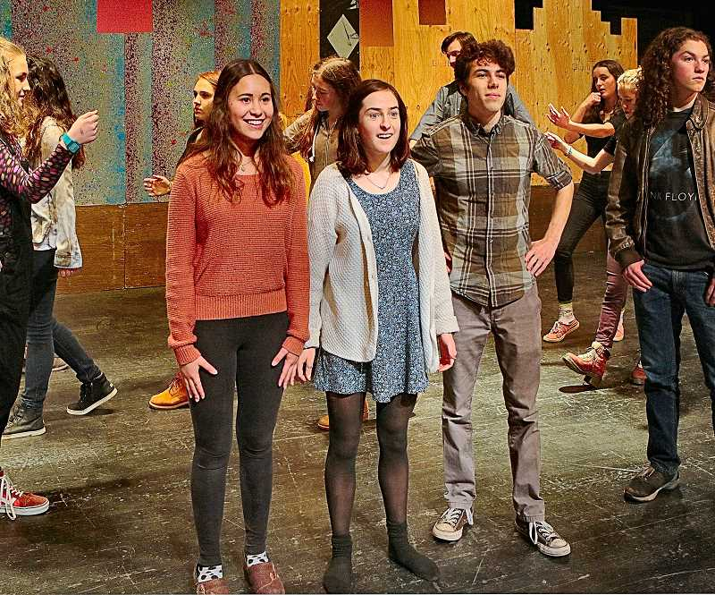 DAVID F. ASHTON - Rehearsing for the upcoming musical Annie - FHS student actors Kristina Strommer (as Grace Farrell the secretary), Mica Hastings (who plays Annie), and Kieran Andrews (playing Oliver Daddy Warbucks) stroll the streets of New York City.