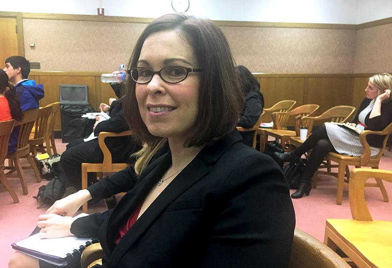 PARIS ACHEN/CAPITAL BUREAU - Heather Kell of Portland sits in the Senate Judiciary Committee meeting at the Capitol in Salem Tuesday, Feb. 21, after testimony on a bill to prohibit employers from firing employees who use marijuana.