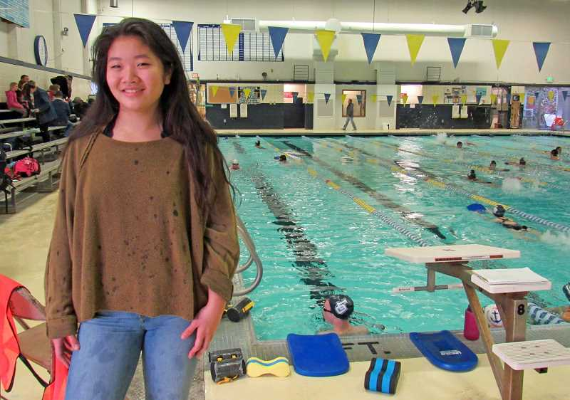 REVIEW PHOTO: JILLIAN DALEY - Jenny Kwon is a Lake Oswego High School senior who helps special needs students on the swim team (and the cross-country team as well) to grow as athletes.