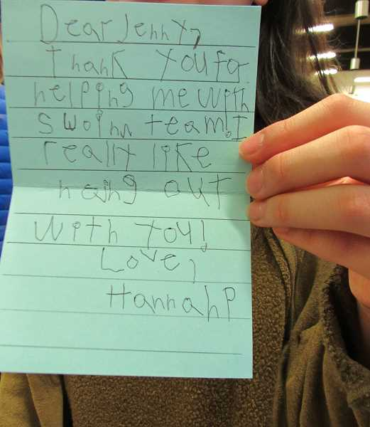 REVIEW PHOTO: JILLIAN DALEY - Hannah Pebley wrote a note to her peer swim team coach, Jenny Kwon.