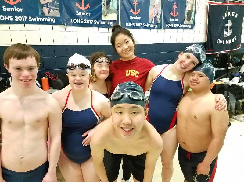 SUBMITTED PHOTO: COURTESY OF TAMMY PEBLEY - Jenny Kwon and her fellow swimmers share a moment. From left: George Wadell, Megan Schiedler, Hannah Pebley, Kwon, Courtney Brase, Irvin Herrera, and, in front, Jeremy Chen.