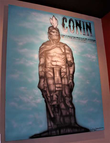 A painting depicting Conin, after whom the restaurant is named and who helped found the restaurateurs' home, hangs on a wall at Conin Mexican Cuisine.