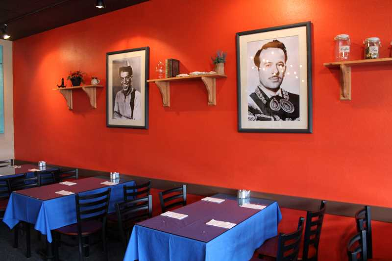 The walls of Conin Mexican Cuisine are a striking shade of orange, but are sparsely decorated but for a few small trinkets and photographs of Mexican cultural figures.