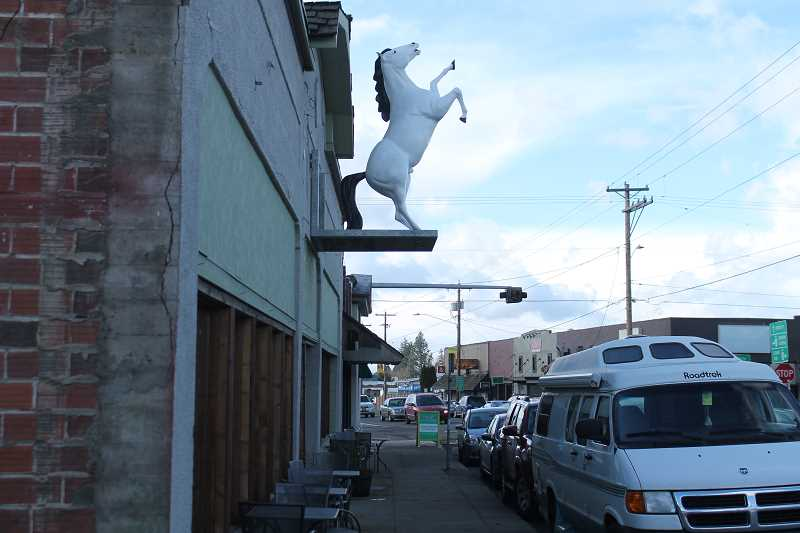 PIONEER PHOTO: CONNER WILLIAMS  - The horse overlooks all of downtown Molalla outside The White Horse restaurant on Main Street.