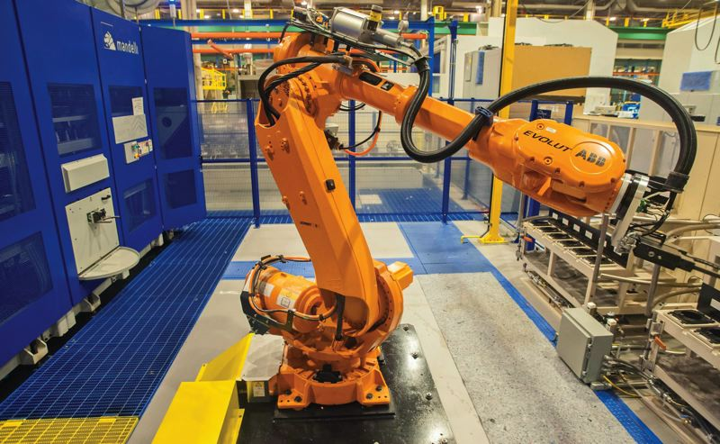 PAMPLIN MEDIA GROUP FILE PHOTO - A Mandelli machine at Boeing's plant in Gresham uses a robot to pluck the correct milling spindle and put them into place to fashion a wing component. Operations Technology Managers are increasingly neeed to mediate between the engineers who run such machines and write the software and the executives running the company.