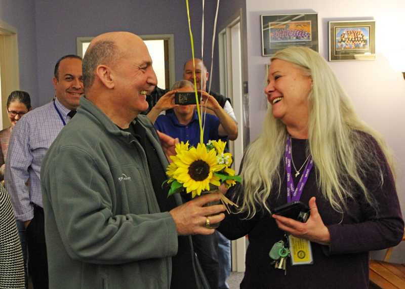 INDEPENDENT PHOTO: JULIA COMNES - Chamber member Bob Rhoades presented WAAST Principal Geri Federico with the Outstanding Educator award during a WAAST staff meeting on Friday morning.
