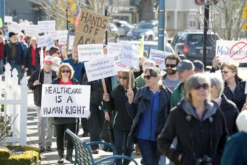 Rally to keep Obamacare draws more than 100 to Sherwood Cannery Square Plaza Saturday