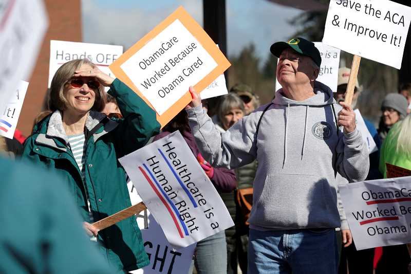 PAMPLIN MEDIA GROUP: JON HOUSE - People rallied in downtown Sherwood to support Obamacare on Feb. 25.