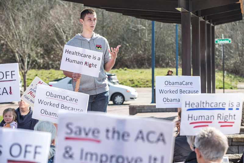 PAMPLIN MEDIA GROUP: JON HOUSE - Sherwood High School student Matthew Schantin gives a speech during a pro-Obamacare rally in downtown Sherwood.