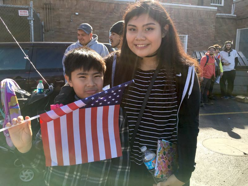 TRIBUNE PHOTO: LYNDSEY HEWITT - Irina Bautista, 18, poses with her little brother, Jorge. The two live in the Normandy apartment complex in Cully and are facing displacement because of a 100 percent rent increase.