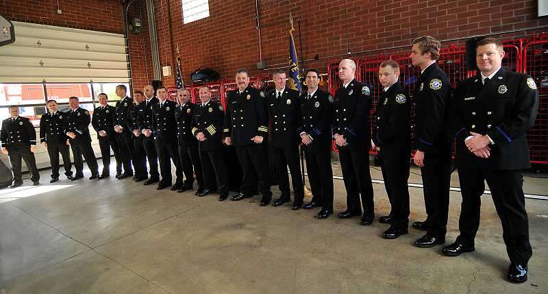REVIEW PHOTO: VERN UYETAKE - Newly promoted Lake Oswego Fire Department employees stand together after a special ceremony on Saturday. 'It's exciting times for us,' says LOFD Fire Marshal Gert Zoutendijk, 'to see our younger talent grow up and become part of the leadership.'